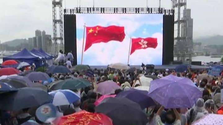 Pro-democracy and pro-government forces stage dueling protests in Hong Kong
