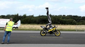 Motorcyclist sets headstand record at 76 mph