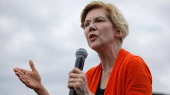 Warren calls for scrapping 1994 crime bill, in swipe at Biden