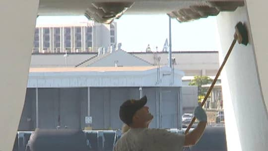 USS Arizona Memorial at Pearl Harbor on track for reopening, as Navy volunteers help to clean up iconic site