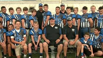 Youth football league wears 'Thin Blue Line' uniforms to honor law enforcement