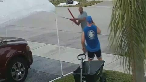 Raw video: Fla. man pulls sword on another man in trash dispute