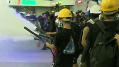Hong Kong police and protesters clash at train station