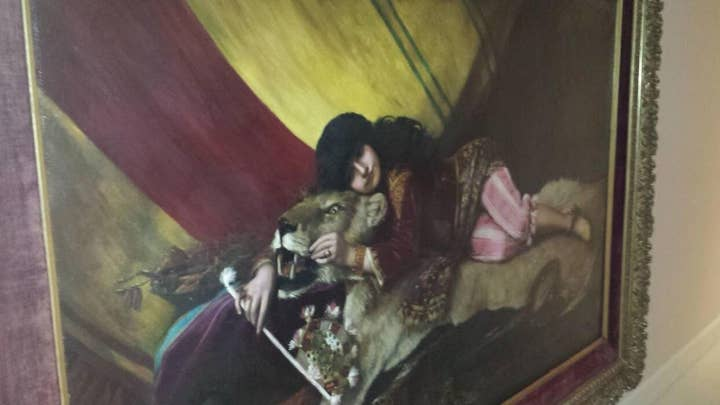 Jeffrey Epstein had painting of girl lying with 'big cat'