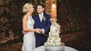 Exact moment of couple's wedding cake disaster caught on camera: 'It felt like slow motion'