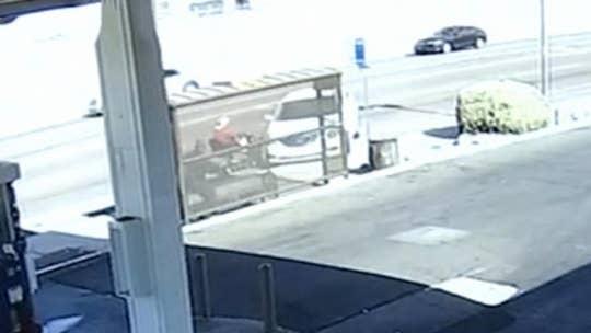 Car loses control, crashes into bus stop