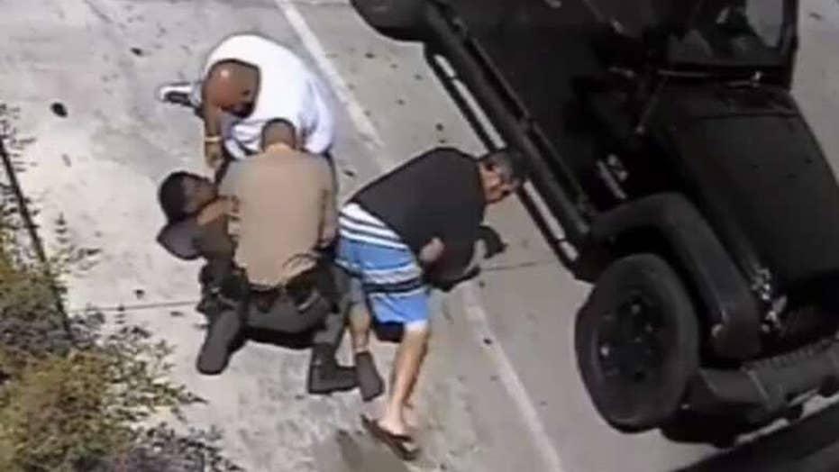 Good Samaritans rush to help cop under attack in California