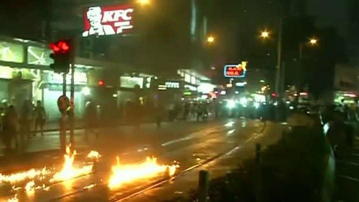 Hong Kong protestors set fires in the streets
