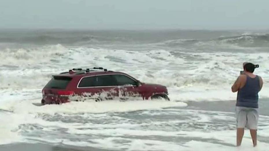 Hurricane Dorian's waves swamp SUV in Myrtle Beach, S.C.