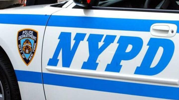 Milk hurled at NYPD officer on scene of fire in Bronx