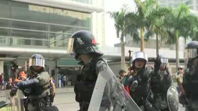 Hong Kong riot police take on protesters as street demonstrations continue