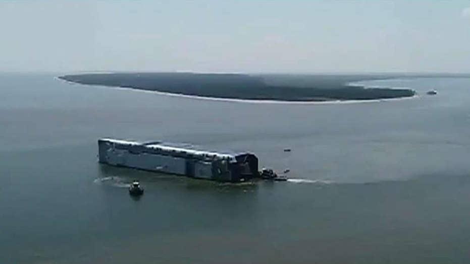 Cargo ship overturns near Georgia port, 4 missing crew members