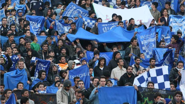 Iranian female soccer fan 'blue girl' dies after setting herself on fire