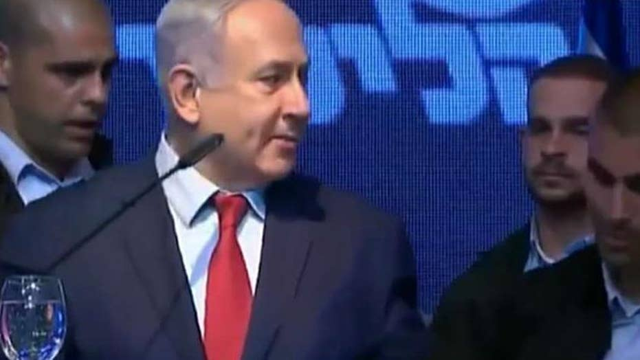 Israeli security forces rush Prime Minister Benjamin Netanyahu from stage after rockets were fired into Israel