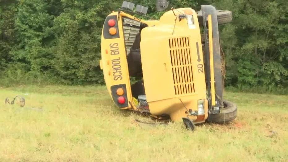 Driver dead in school bus crash, 4 children airlifted from scene: reports