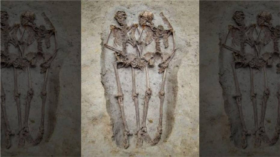 Experts: Mysterious ancient skeleton 'lovers' are both male