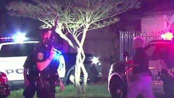 Houston cop shot, search for suspect underway