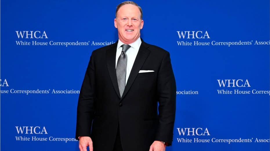 Sean Spicer appearance in Chicago draws protesters – including one who rushed the stage