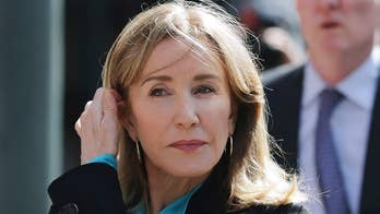 Felicity Huffman reports to prison for her role in college admissions scandal