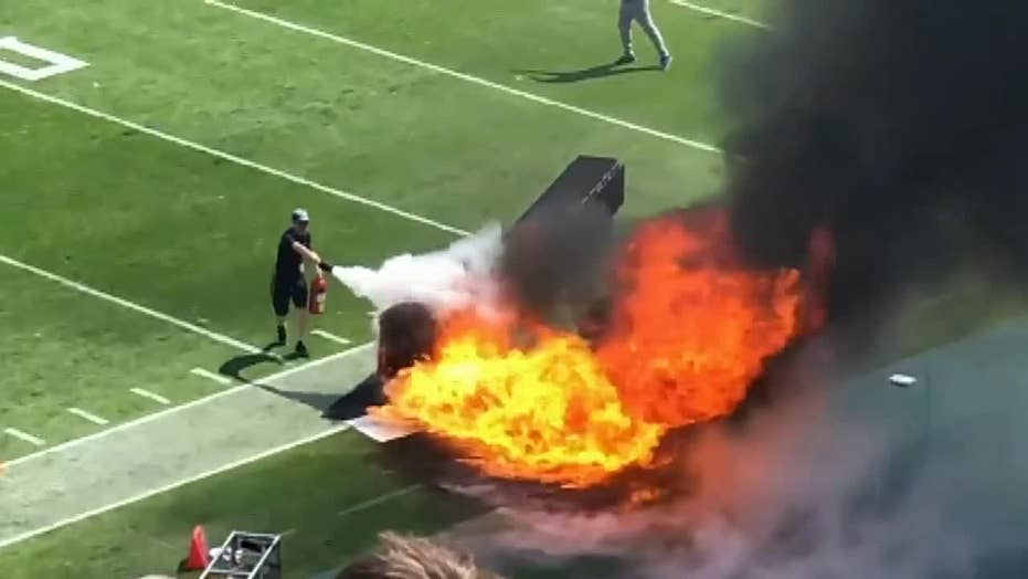 Fire sparks during Titans' pregame ceremony for their home opener at Nissan Stadium in Nashville, Tennessee on Sunday.
