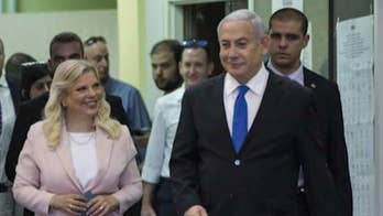 Benjamin Netanyahu faces unknown political fate as Israeli exit polls show tight race