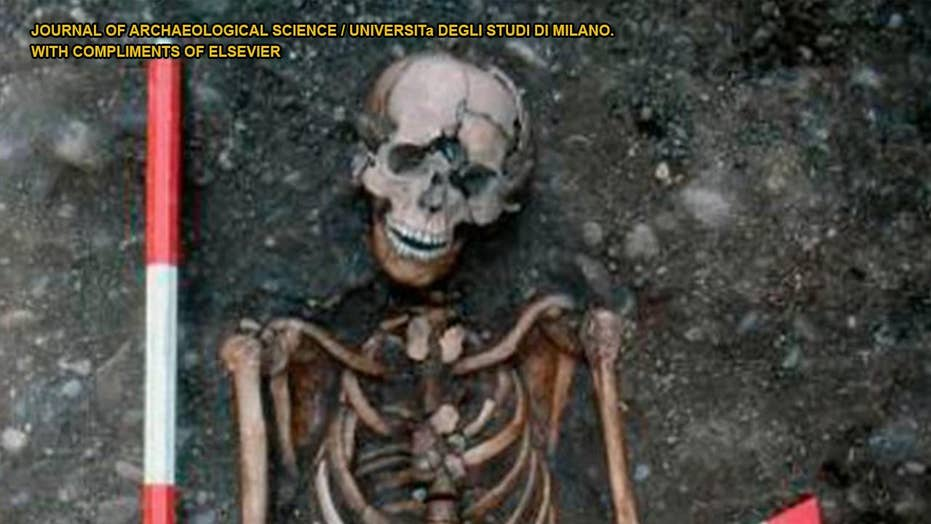 Medieval skeleton shows visible signs of 'decapitation' and