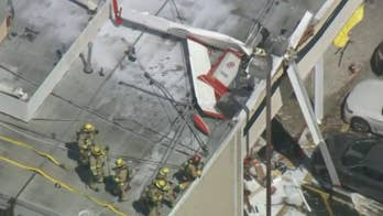 One dead, one injured after small plane crashes onto strip mall roof in California