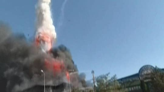Turkey chemical factory explosion launches metal tank into sky above fleeing onlookers, video shows