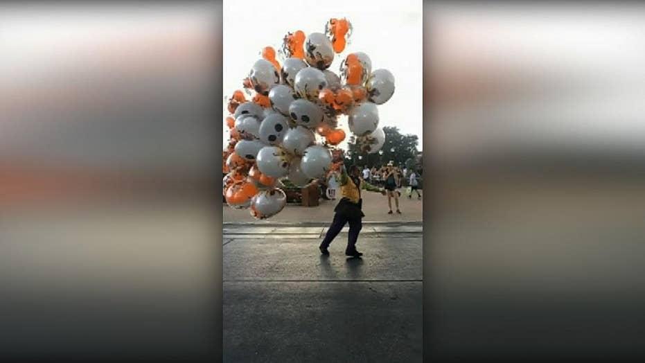 Walt Disney World employee nearly blown away by strong wind