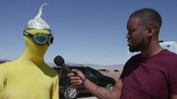 Lawrence Jones checks in with 'Raid Area 51' attendees