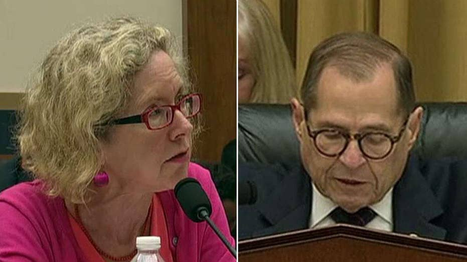 Heated rhetoric at congressional hearing on policing in America