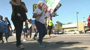 Pro-ICE and anti-ICE protestors face off in Denver, Colorado