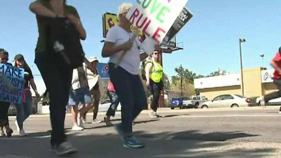 Pro-ICE and anti-ICE protestors face off in Denver, Colorado