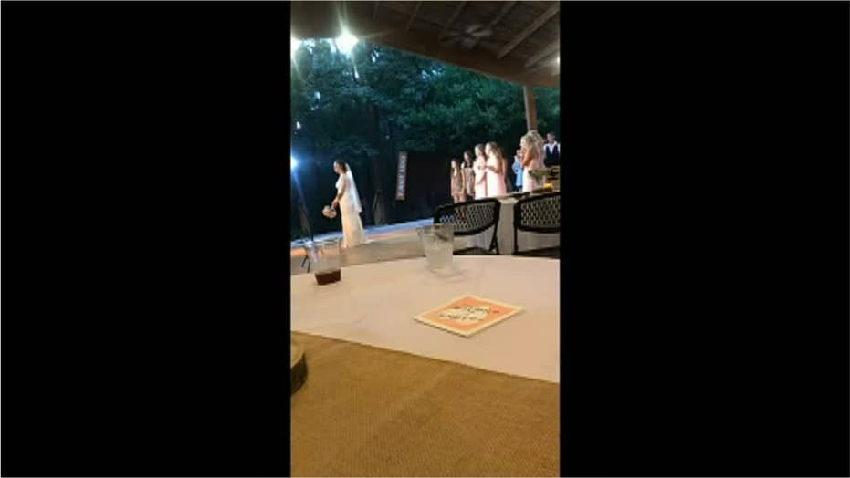 Watch: Wedding guest flees reception after girlfriend catches bride's bouquet