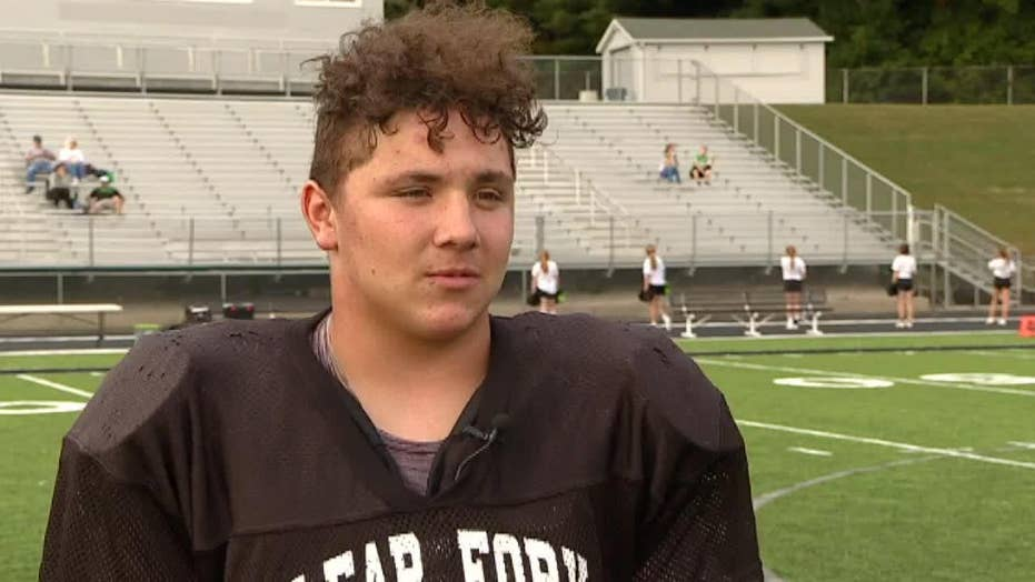 16-year-old football player lifts a car and saves his neighbor's life