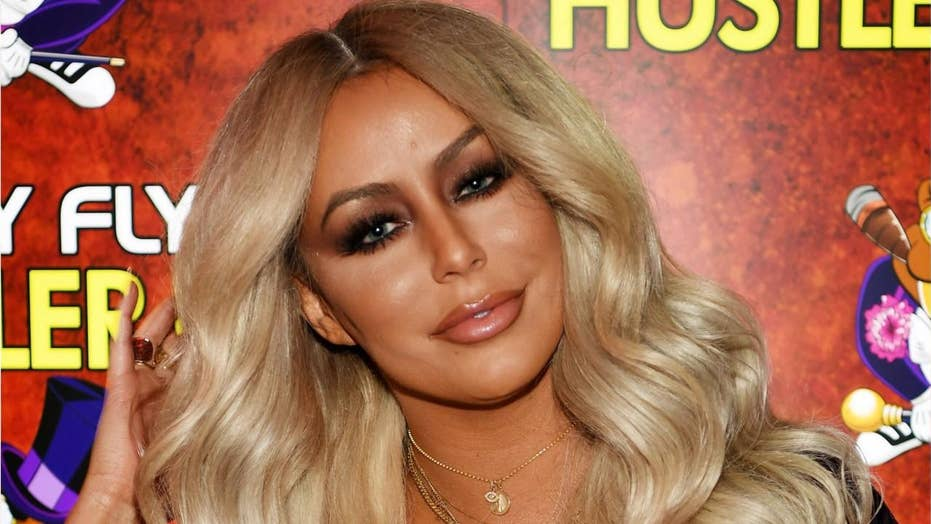 Aubrey O'Day says an American Airlines flight attendant made her take her shirt off 'in front of the entire plane'