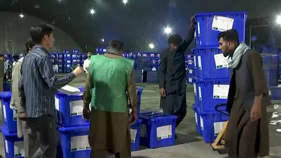 Afghanistan deploys more than 100,000 troops to guard polling stations