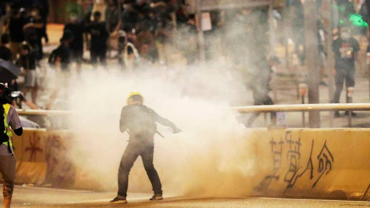 Hong Kong police use tear gas, water cannons to disperse demonstrators