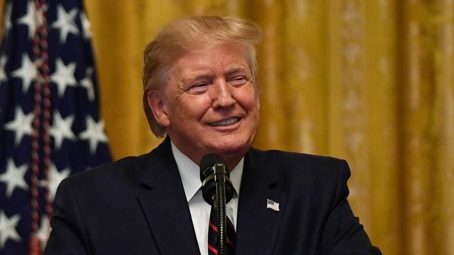 Trump takes aim at whistleblower, the press amid impeachment push