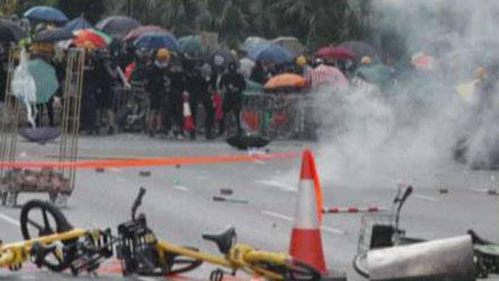 Hong Kong police shoot protester in close range
