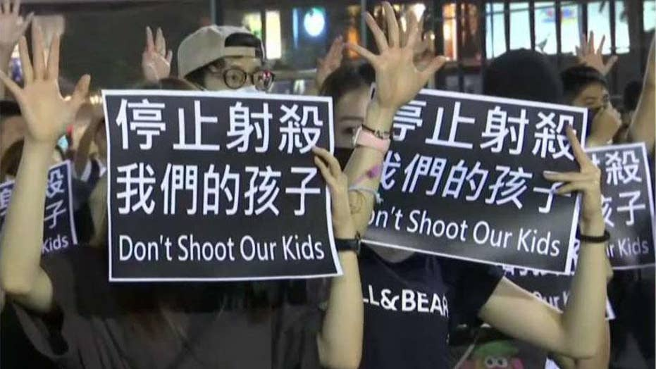 Hong Kong protests erupt after police shooting of teenage demonstrator