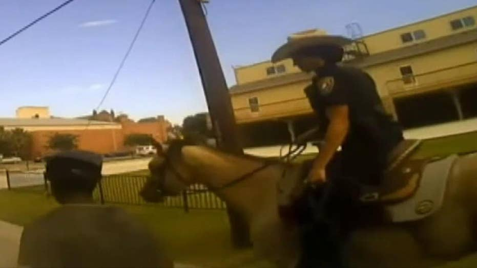 Texas man seeks $1M after viral photo shows mounted officers leading him by rope