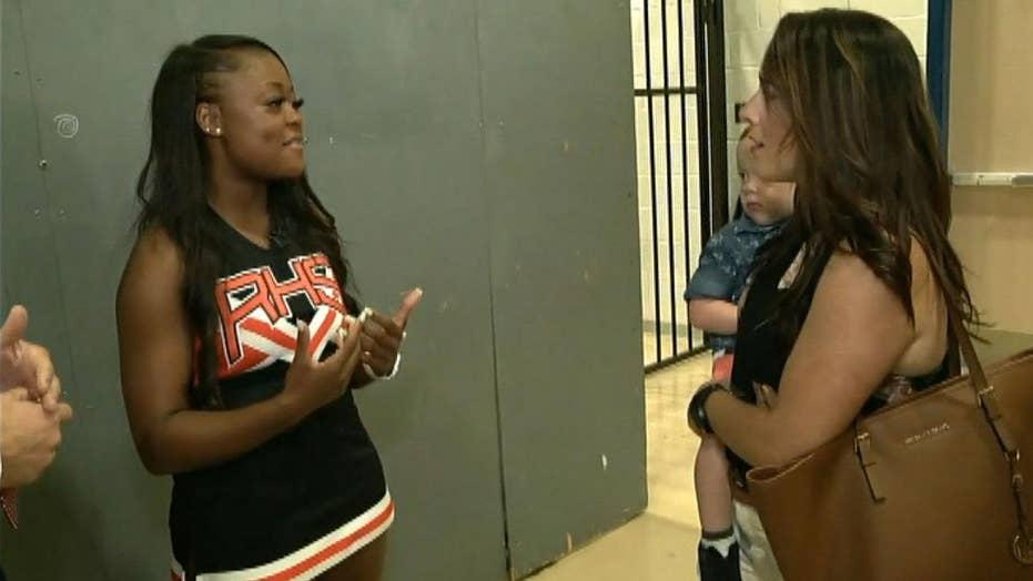 Texas cheerleader saves choking child during parade