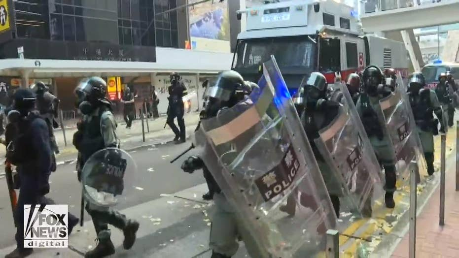 Hong Kong protests become violent as police engage protesters, media