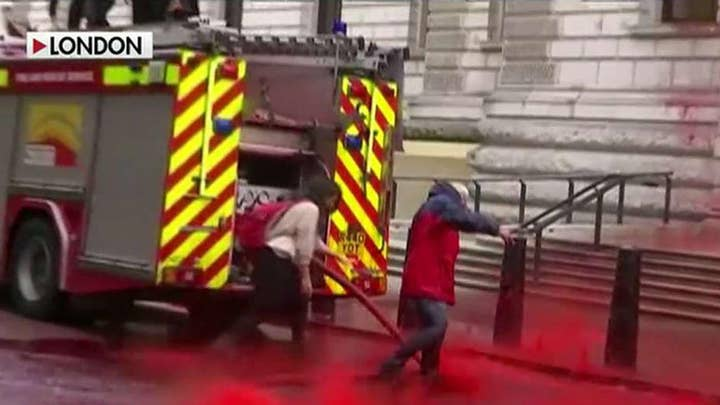 Climate activists spray UK's Treasury building with fake blood