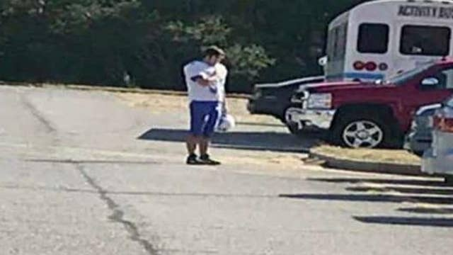 High school student stops to salute flag after hearing National Anthem