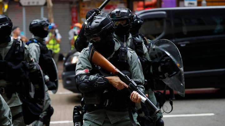 Thousands defy mask ban in Hong Kong