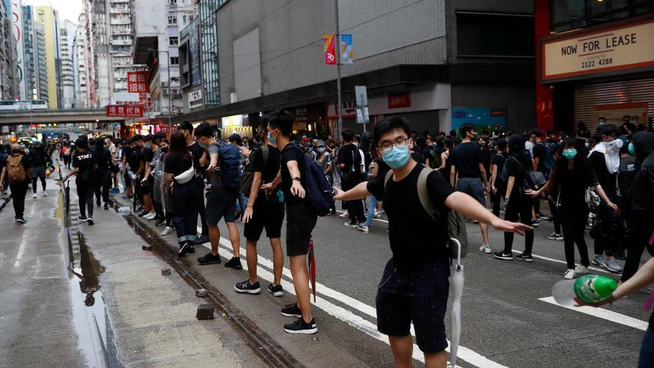 Hong Kong rallies turn violent after thousands defy face mask ban