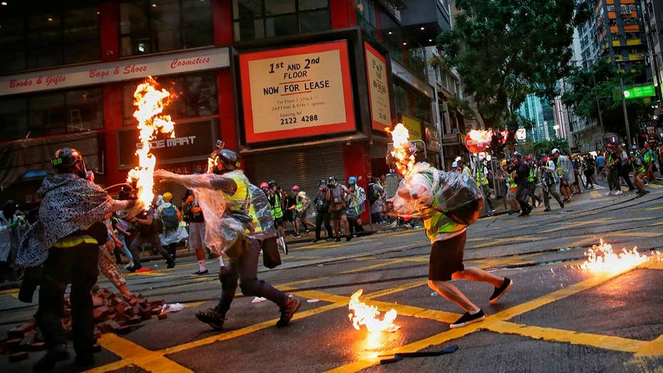 Hong Kong rallies turn violent as protesters defy face mask ban