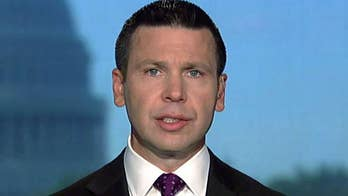 McAleenan reacts to being shouted off stage at Georgetown Law School